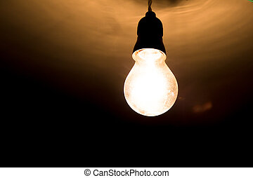 Lighbulb hanging from the ceiling.
