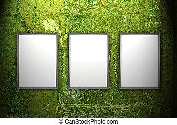 Light ad display on green grunge wall. Advertising...