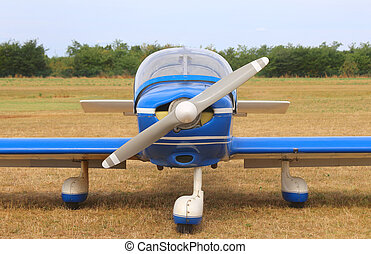 light aircraft at the airport with a propeller ready for takeoff