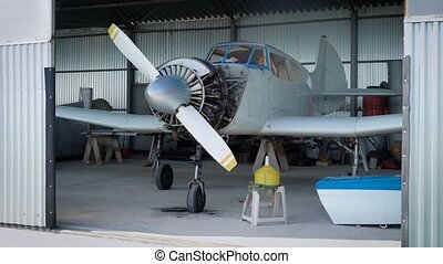 light aircraft in the hangar. Engine casing removed, it seems not repair.