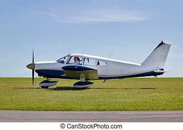 Light aircraft take off - Light aircraft taxiing on a grass ...