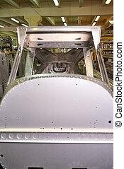 Light airplane body part, workshop.
