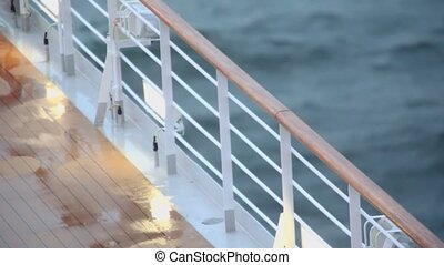 Light and fence with handrail on deck of ship
