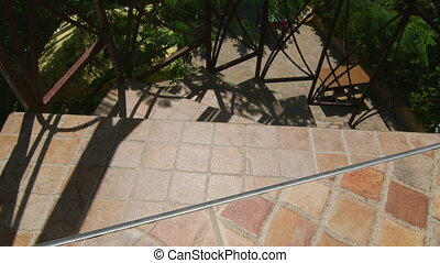 Light and shadow on ceramic tiled spiral staircase outdoor