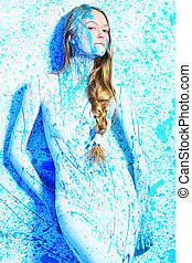 light - Art project: beautiful woman painted with many vivid...