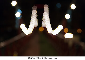 light at red footbridge at night, blur background