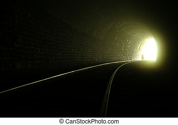 Light at the end of tunnel - A silhouette near the exit from...