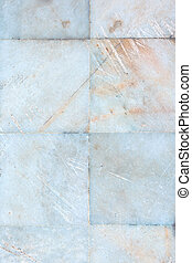 Light background with marble texture. The wall is lined with tiles of stone.