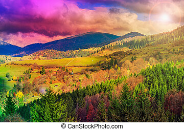 light  beam falls on hillside with autumn forest in mountain