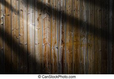 Light beam on wooden background
