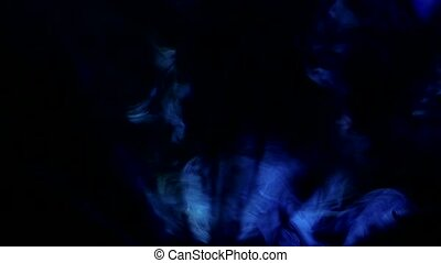Light beams from movie projector, background of smoky dark studio