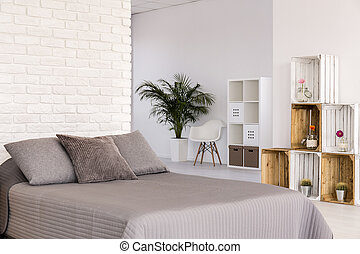 Light bedroom in scandinavian style - White interior with...