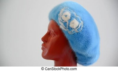 light blue beret from natural mink on mannequin. Side view -...
