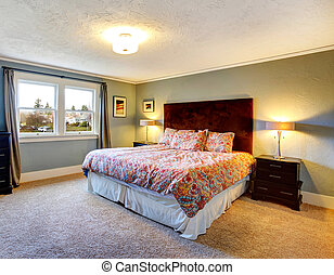 Light blue furnished bedroom with carpeted floor