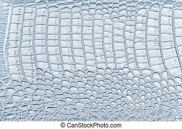 Light blue leather texture background, closeup. Reptile skin, macro.