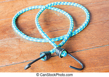 Light blue rubber band with metal hooks
