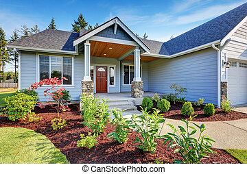 Light blue siding house . Porch with stone base columns.