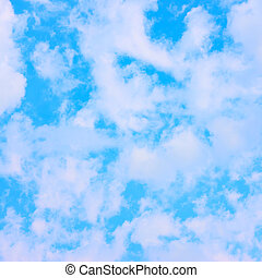 Light blue spring sky with clouds