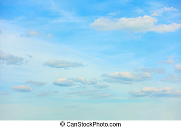 Light blue summer sky with clouds