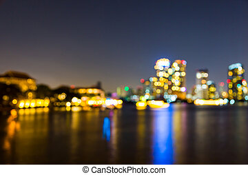 light bokeh of city on the river at night