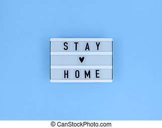Light box with Stay home quote on a blue background.