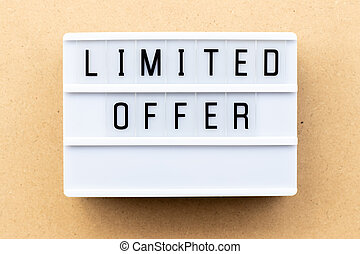 Light box with word limited offer on wood background