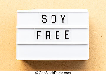 Light box with word soy free on wood background
