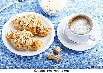light breakfast croissants and coffee