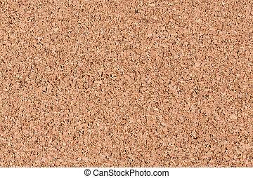 Light brown cork wood panel background.