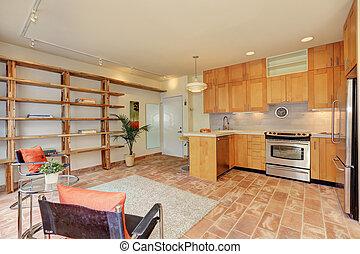 Light brown kitchen interior with sitting area.