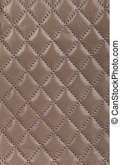 Light brown quilted leather background