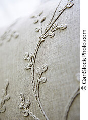 Light brown sofa with floral pattern embroidery