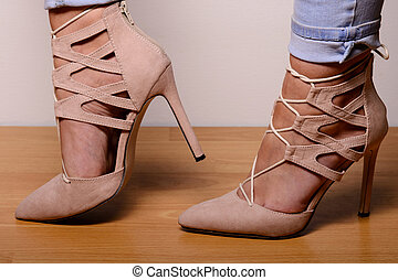 Light brown suede high-heeled shoes dressed in the girl