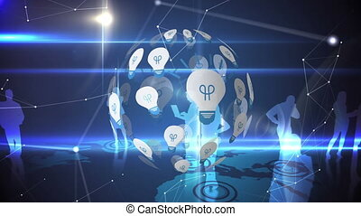 Light bulb and silhouette of business people