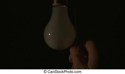 Light bulb being turned on