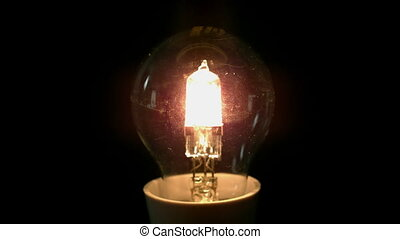 Light bulb exploding on black background - Light bulb...