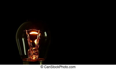 light bulb filament lighting up. Three different views in...