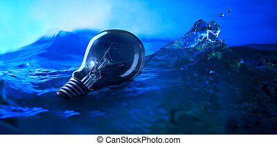 light bulb floating on sea with win