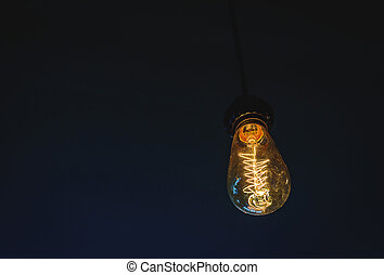 Light bulb glowing in the dark.
