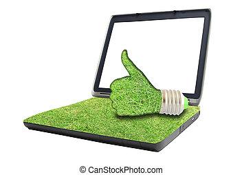 light bulb hand on laptop