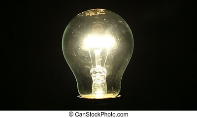 Light bulb illuminates a dark room