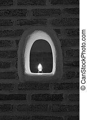 Light bulb in brick wall