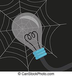 Light bulb in spiderweb on dark background