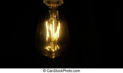 Light bulb lamp on black background. Edison light bulbs in darkness
