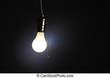 Old fashioned light bulb with pull chain