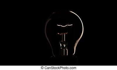 Light bulb on black background - Light bulb