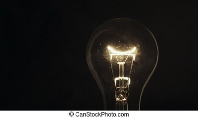 Light bulb on black background. Idea light bulb