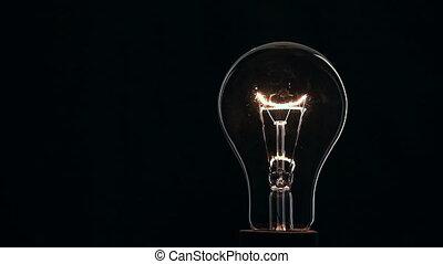 Light bulb on black background.