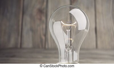 Light bulb on wood background