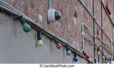 Light bulbs attached to pipes - A medium shot of light bulbs...
